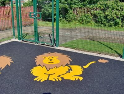 Wetpour soft rubber safety surface with lion images at a Glasgow School